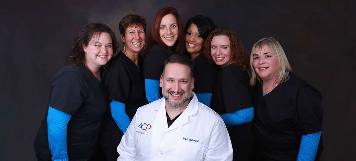 Dr. Schumacher & his dental team