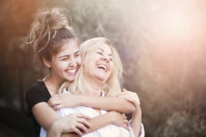 two women smiling happy