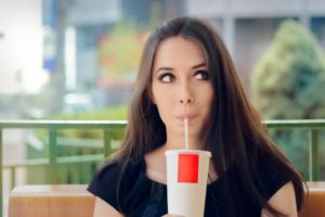 woman sipping soda