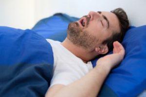 A man snoring at night