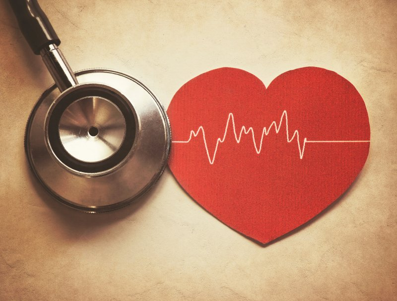 a stethoscope next to a red heart for American Heart Association Month
